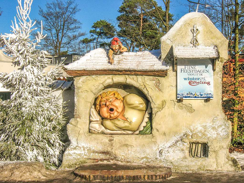 a fat gobbler with an open mouth that serves as a dust bin and a a Christmas tree with artificial snow at the Efteling