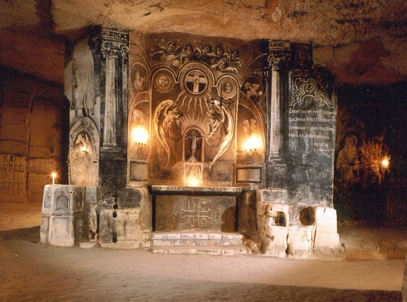 Murals made with charcoal looking like an altar in an underground chalk-winning quarry, Fluweelengrot in Valkenburg