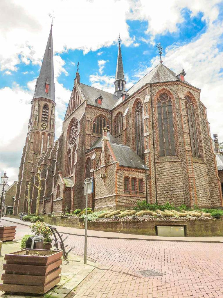 a beautiful church Gothic Revival Style and a blue sky with white clouds, Saint Paul's Church in Vaals
