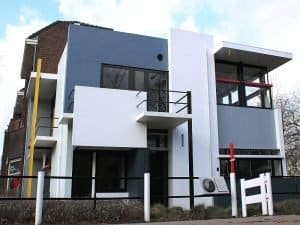 a modern house with large white squares and yellow, red and blue details, UNESCO Rietveld-Schröder House in Utrecht, Netherlands
