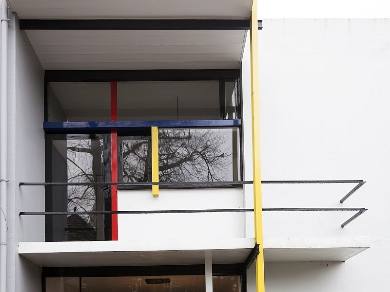 a balcony of a modern house with yellow, blue and red details, Rietveld-Schröder House in Utrecht, Netherlands