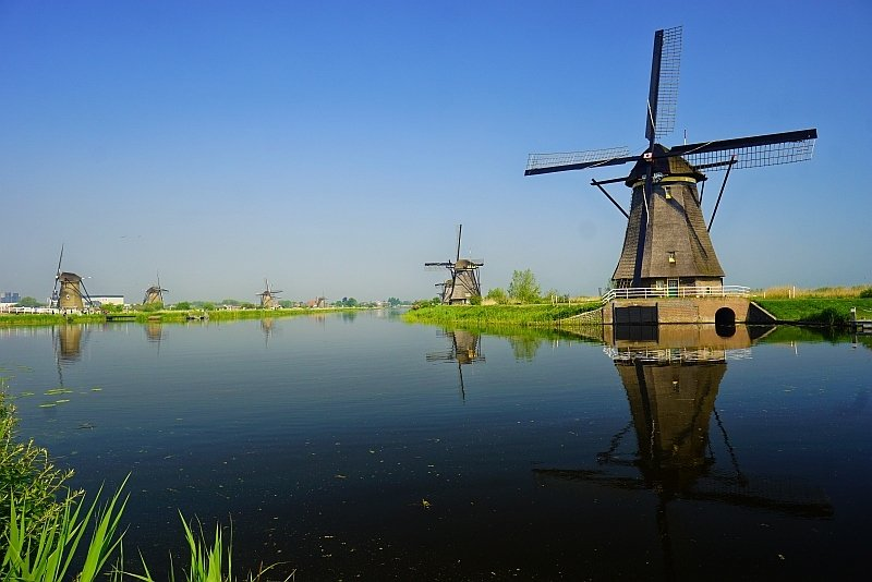 windmills alongside water, UNESCO Kinderdijk