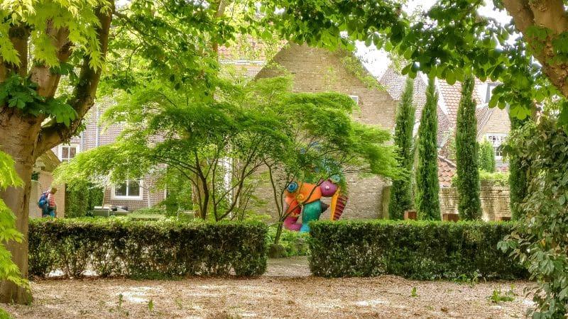 a colorful art sculpture in a green park, Heusden