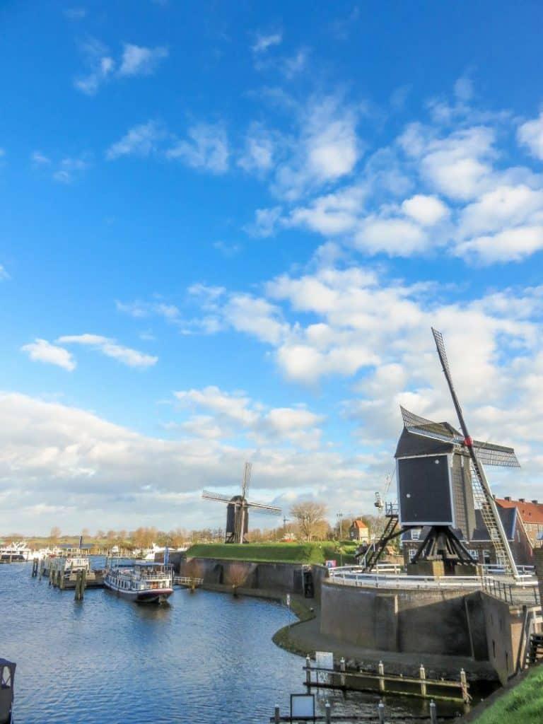 two windmills on a dike along a marina, Heusden, the Netherlands